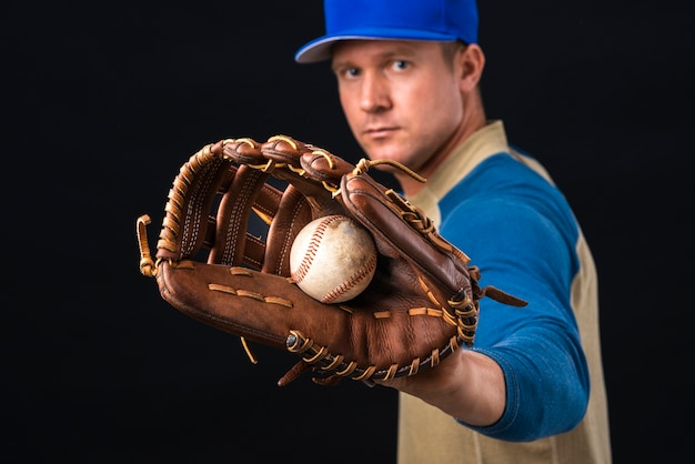 Man holding baseball in glove