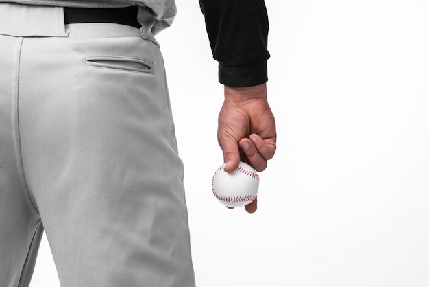 Man holding baseball with back view