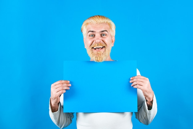 Man holding blank card blank empty paper billboard with copy space for text