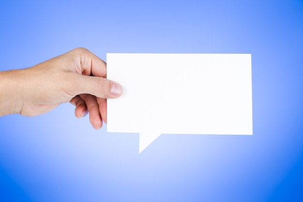 Man holding blank paper speech bubble