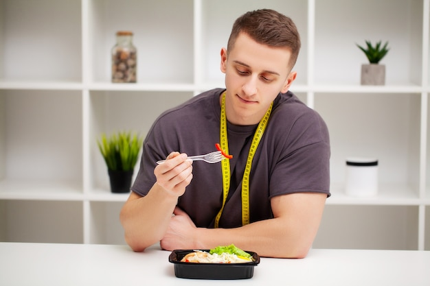 Man holding a box full of protein rich foods for sports nutrition