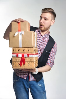 Man holding box with christmas gifts in hands.