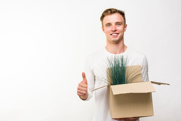 Man holding a box with flowers with copyspace