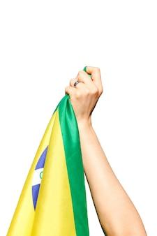 Man holding brazil flag isolated.