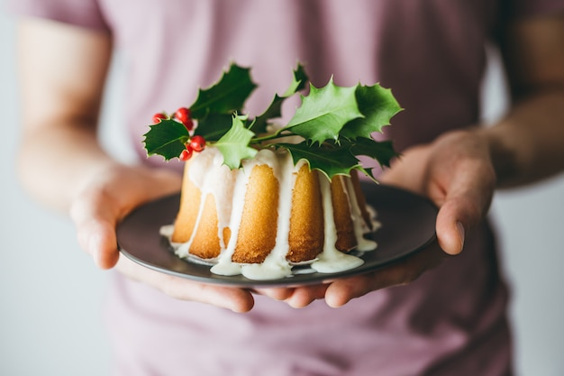 Man holding christmas cake with deco