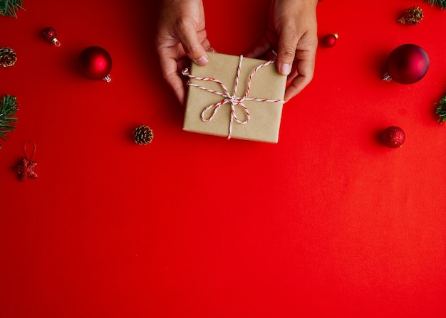 Man holding christmas gift box with decorations