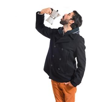 Man holding coffee pot