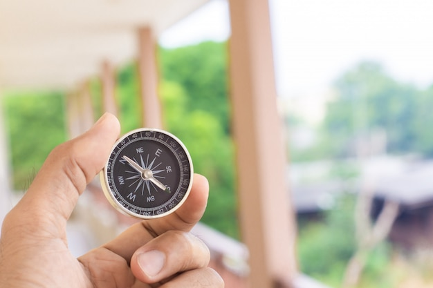 Man holding compass on blurred background. for activity lifestyl