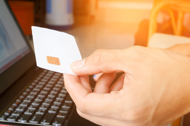 Man holding credit card with laptop. shopping online