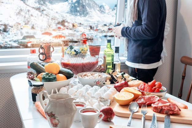 Man holding cup with sightseeing view in winter and preparing foods in christmas