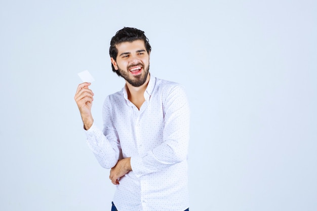Man holding and demonstrating his business card to the new partners