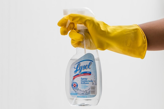 Man holding a disinfectant bottle