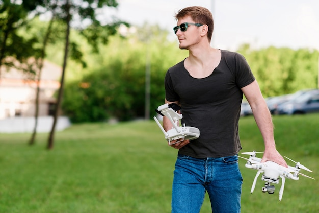 Man holding drone outdoors