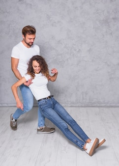 Man holding falling woman from behind