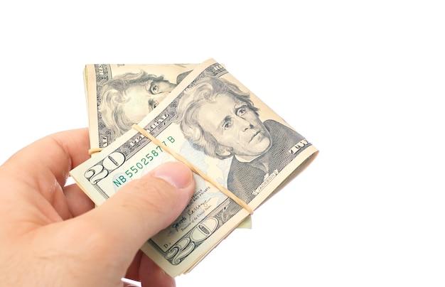 A man holding folded us dollar bills on a white background Premium Photo