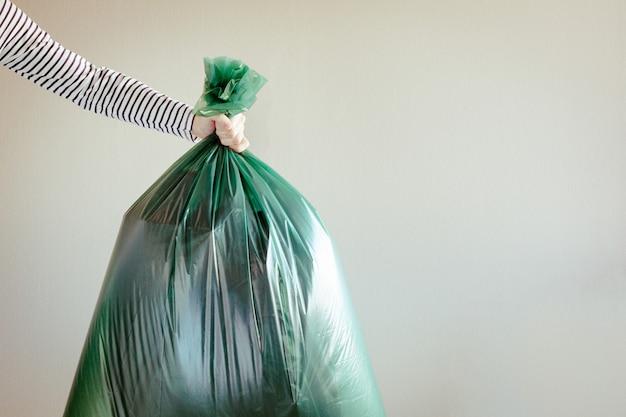 Man holding garbage bag.