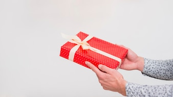 Man holding gift box in wrap