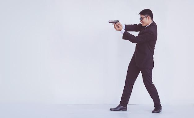 Man holding a gun, smart man
