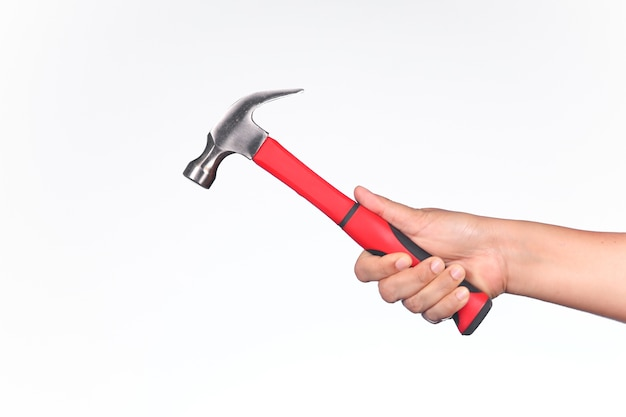 A man holding hammer on white background