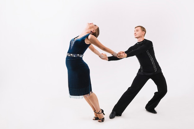 Man holding hands of woman during dance