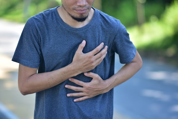 Man holding heart when exercises