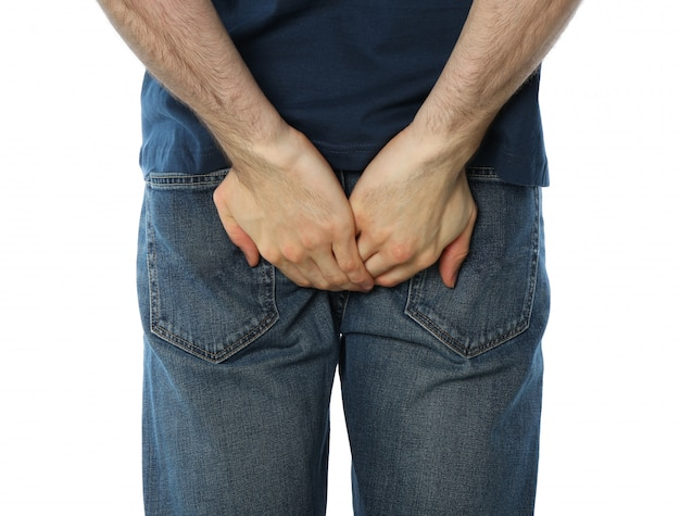 Man holding his butt, isolated