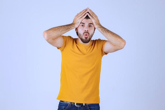 Man holding his head as he has headache.