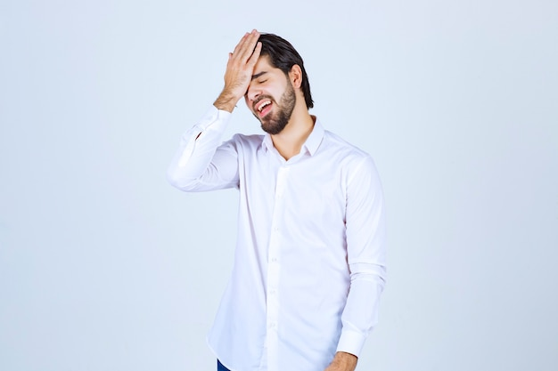 Man holding his head because of headache or feeling exhausted