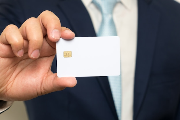 Man holding holding blank credit card