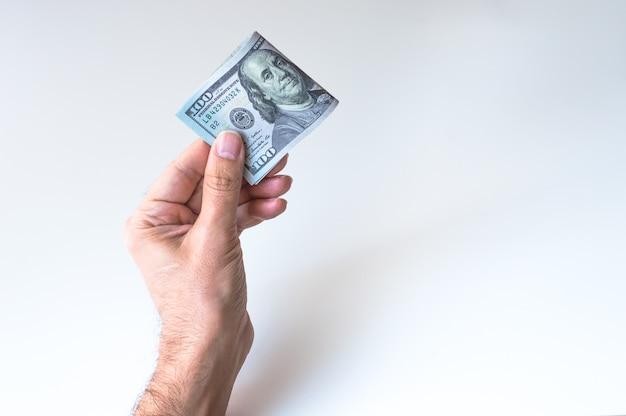 Man holding hundred us dollars