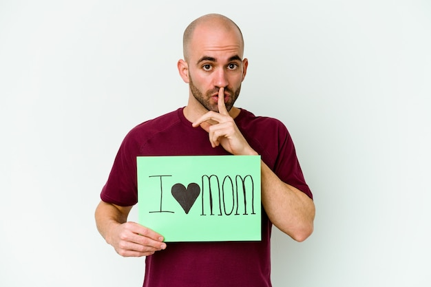 Man holding an i love mom placard