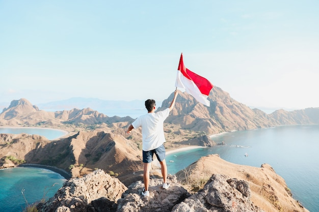 A man holding indonesia flag at labuan bajo