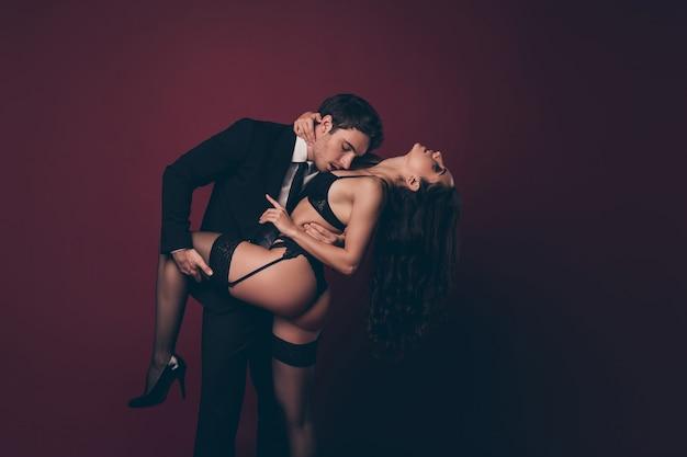 Man holding leg, hip and kiss girl