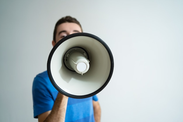 Man holding megaphone in front of his face