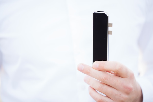 Man holding mini adapter for laptops and flash memory