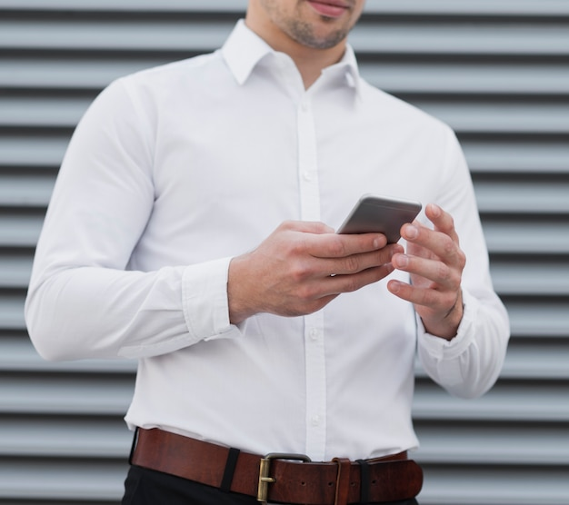 Man holding mobile device close up