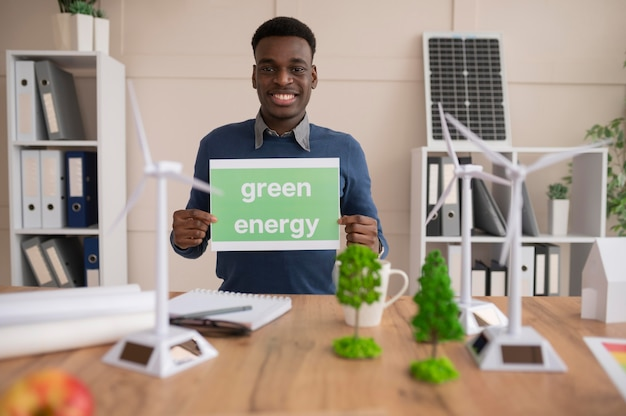 Man holding paper with green energy