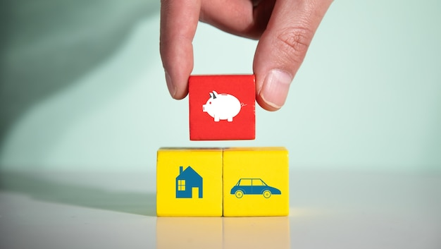 Man holding piggy bank in color cube