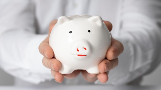 Man holding a piggy bank