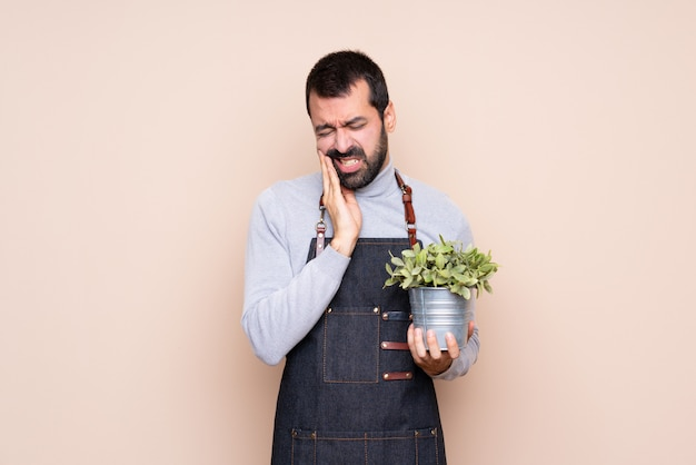 Man holding a plant with toothache