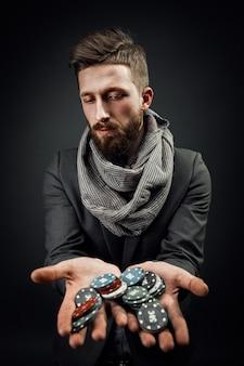 Man holding poker chips