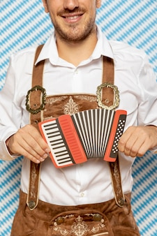Man holding red bandoneon replica