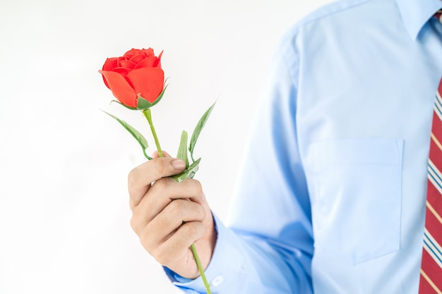 Man holding red rose in hand for valentine