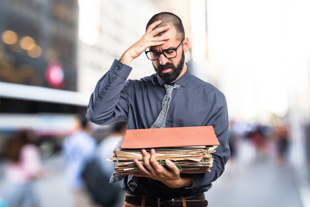 Man holding several college notes