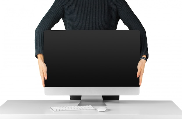 Man holding and showing black computer monitor screen isolated on white