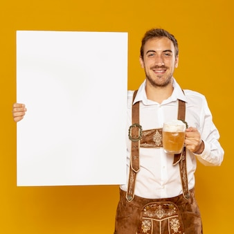 Man holding sign mock-up and beer pint