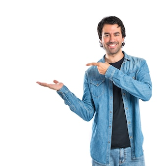 Man holding something over white background