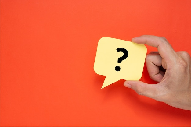 A man holding speech bubble with a question mark