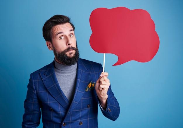 Man holding a speech bubble Free Photo