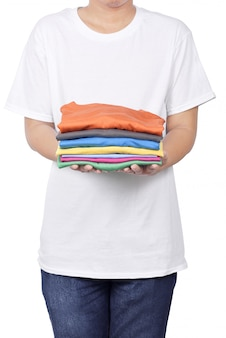 Man holding stack of folded clothes in his hand
